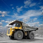 stock-photo-heavy-mining-truck-driving-through-the-iron-ore-opencast-121115248