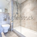 stock-photo-modern-en-suite-bathroom-with-large-shower-toilet-and-wash-basin-in-beige-natural-with-natural-50943832