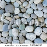 stock-photo-naturally-polished-white-rock-pebbles-background-135964799