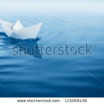 stock-photo-paper-boat-sailing-on-blue-water-surface-115269436