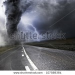 stock-photo-powerful-tornado-destroying-property-with-lightning-in-the-background-107588384