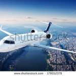 stock-photo-private-jet-plane-in-the-blue-sky-178012379