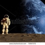 stock-photo-the-astronaut-on-a-background-of-a-planet-70897570