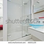 stock-photo-ultra-modern-luxurious-en-suite-bathroom-with-shower-cabin-and-glass-hand-wash-basin-49201129