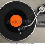 stock-photo-vintage-record-player-with-vinyl-record-87476161
